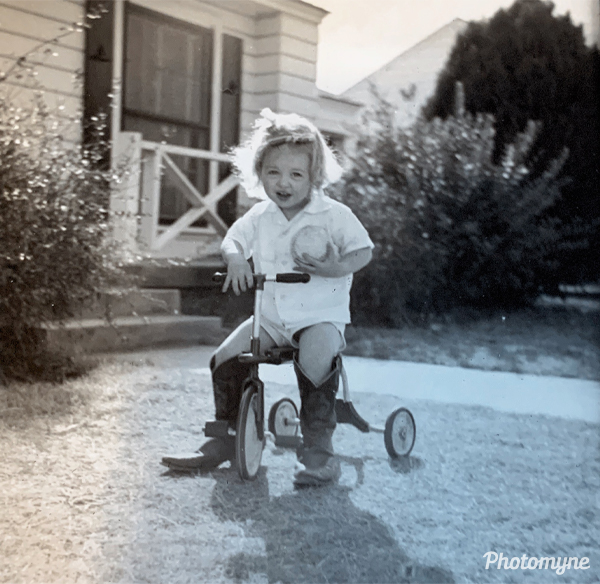 In her boots to ride her bike. USA 1950