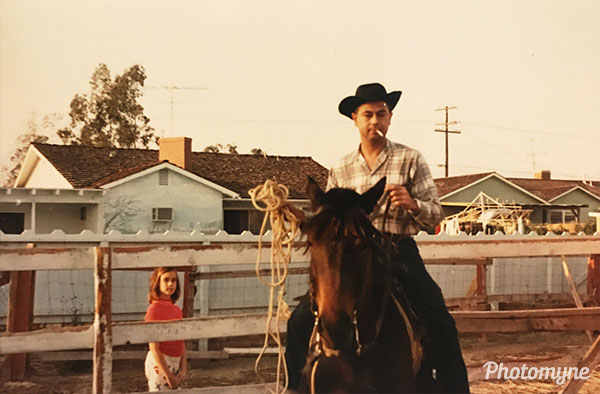 I enviously watch Daddy train a horse while smoking. USA 1968