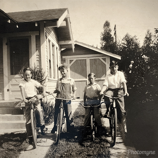 Ward White and his buddies ready to ride. In the driveway of his house in Pomona. USA 1930