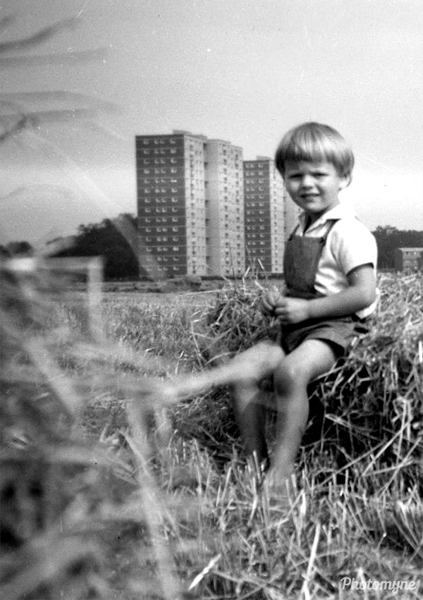 Hamish sitting in the field. UK 1968