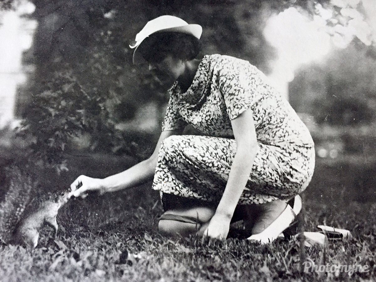 My mother feeding a squirrel at Meridian Hill Park. Washington D.C., USA 1935
