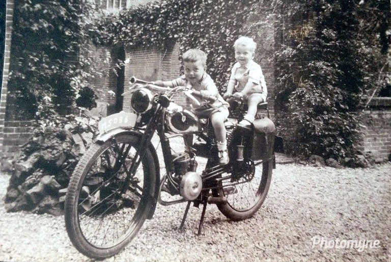 Me and my big brother on dad's motorbike, Nijmegen, Netherlands, 1943