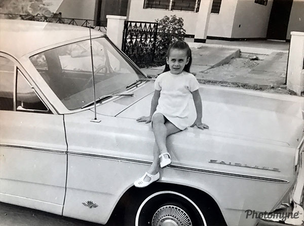 Carolina on Dad's car. Venezuela 1967