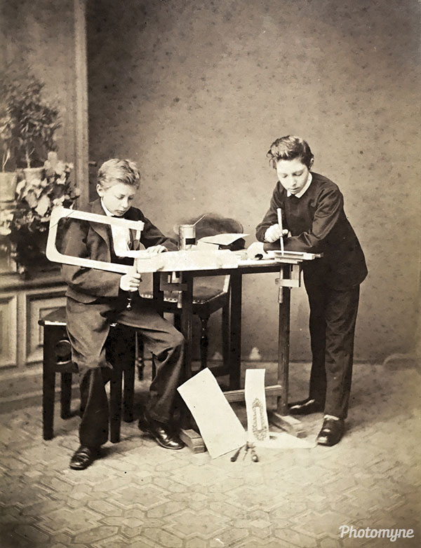 My grandfather and his best friend making jigsaw puzzles in the photographer study. Denmark 1871