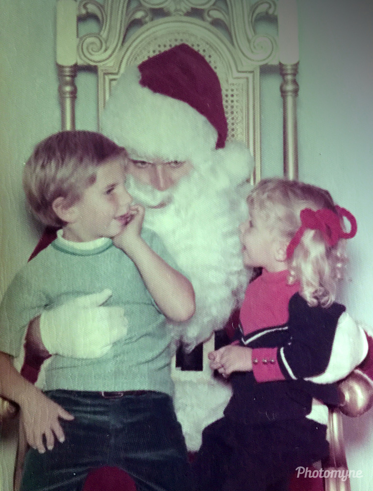 My son 6 yrs, and daughter 2, sitting on Santa's lap at the Mall in Torrance telling Santa their Christmas wishes, Torrance, California, United States, 1972