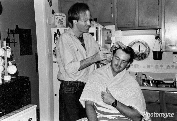 Paul cutting Andy's hair. FL, USA 1990