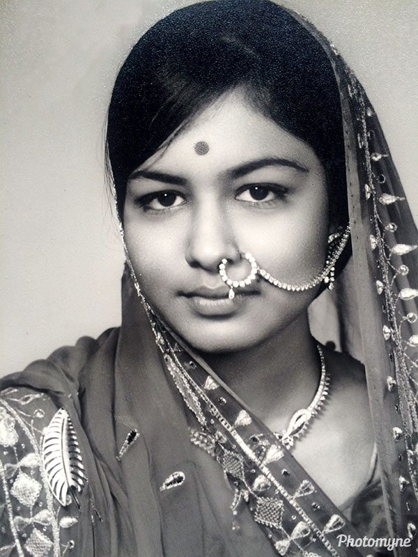 She gazed into the camera lens, contemplating her life ahead as she takes the first step forward into her married life. India 1968