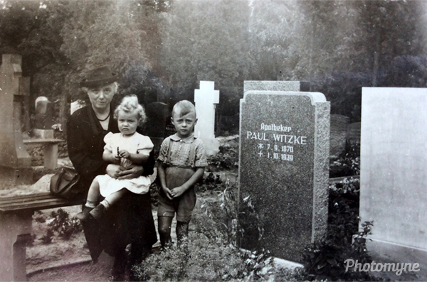 My grandmother, me, and my older brother at the grave of my grandfather. Germany 1940
