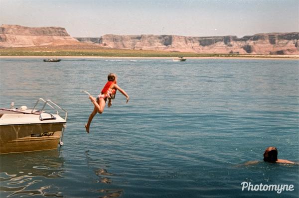 Carissa jumping into lake, Garland watching. USA 1990
