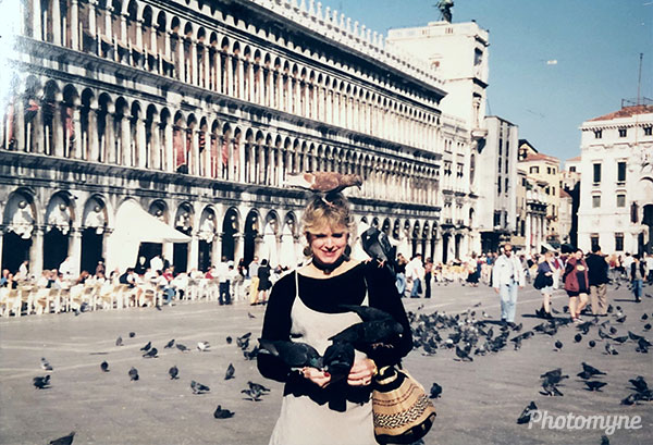 Mary in Venice feeding pigeons. Italy 1995