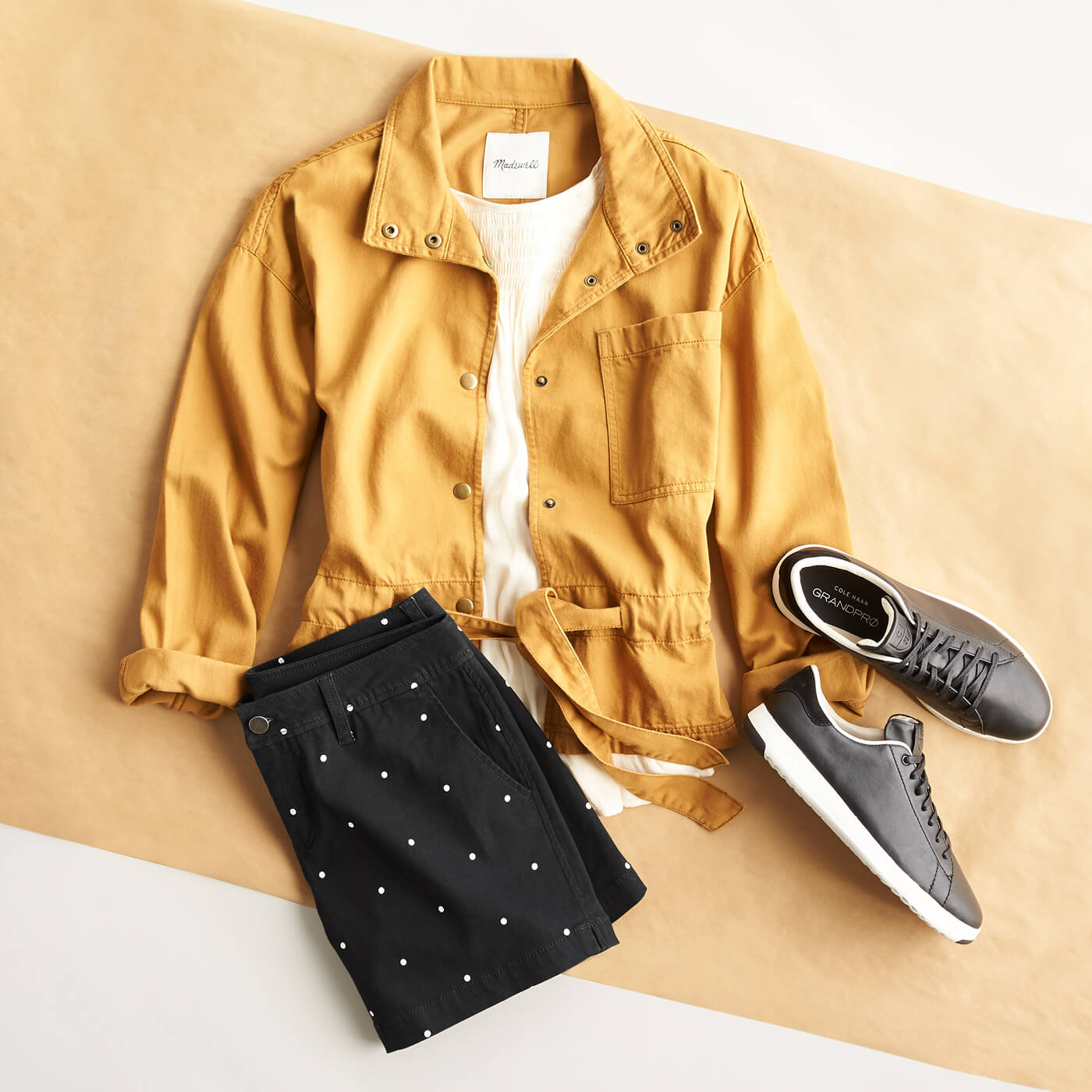 yellow jacket, embroidered shorts and sneakers