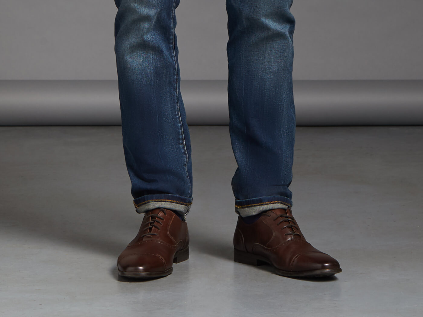 Pairing casual men's shoes with the right jeans can bring your style to new heights while maintaining your comfort level. If shoes are a neutral color, choose jeans featuring darker denim and designed with an average or skinny fit.