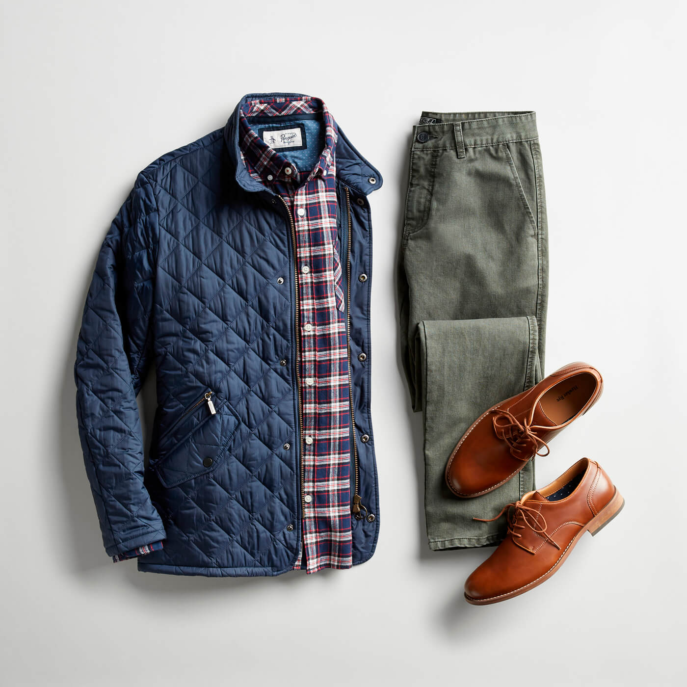blue puffer jacket and grey chinos