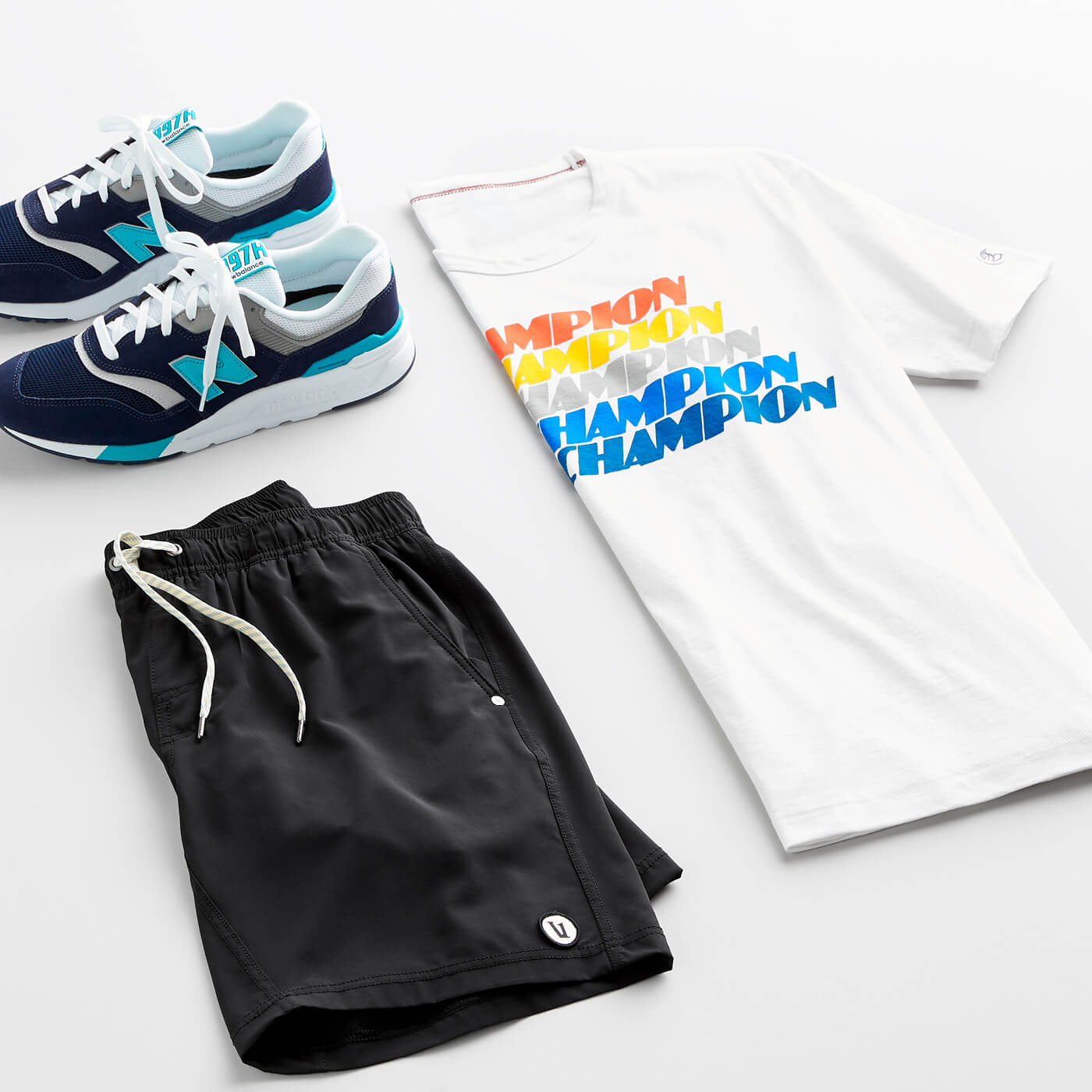men's black boardshorts, graphic tee and sneakers