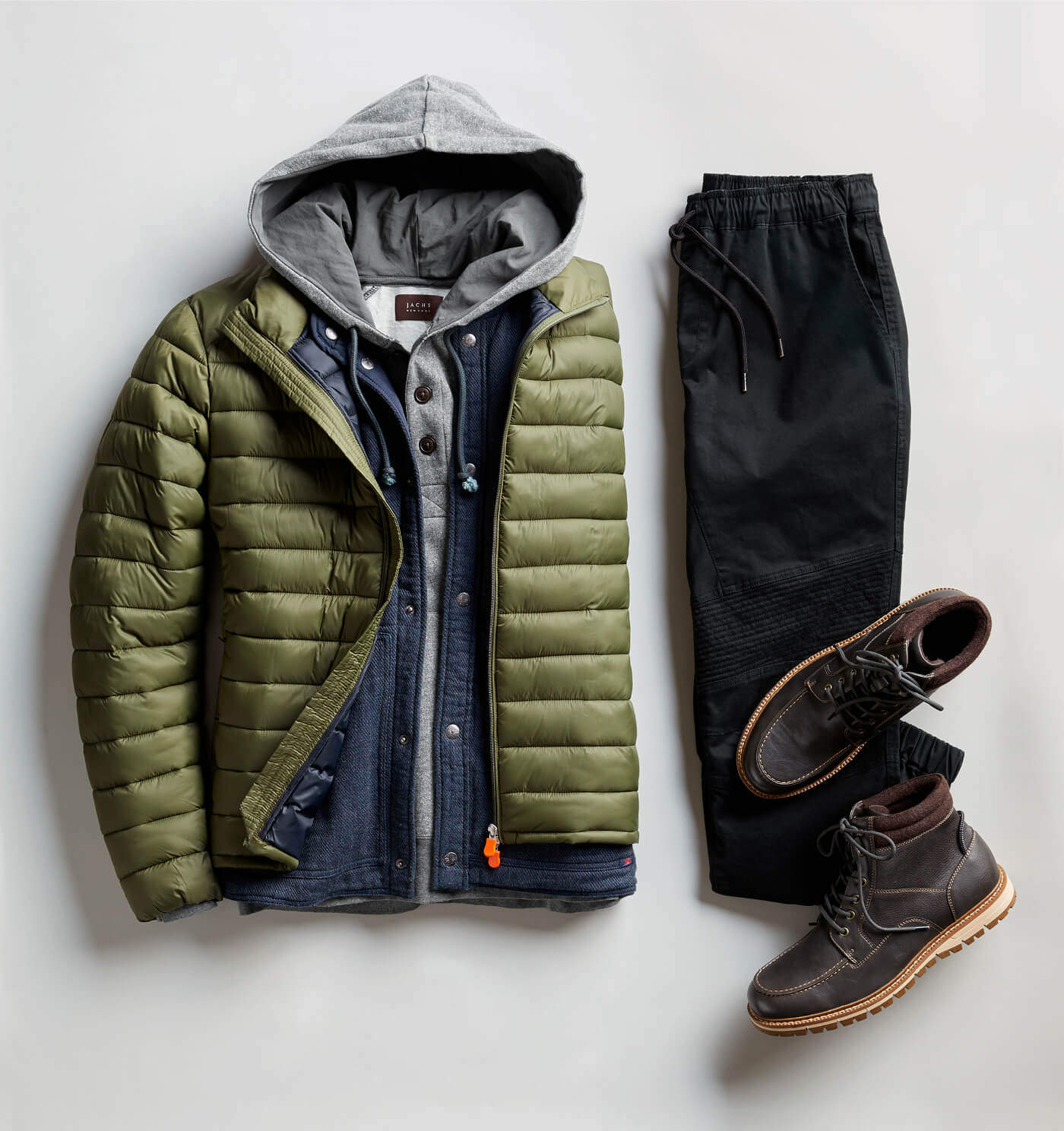 green puffer and black joggers
