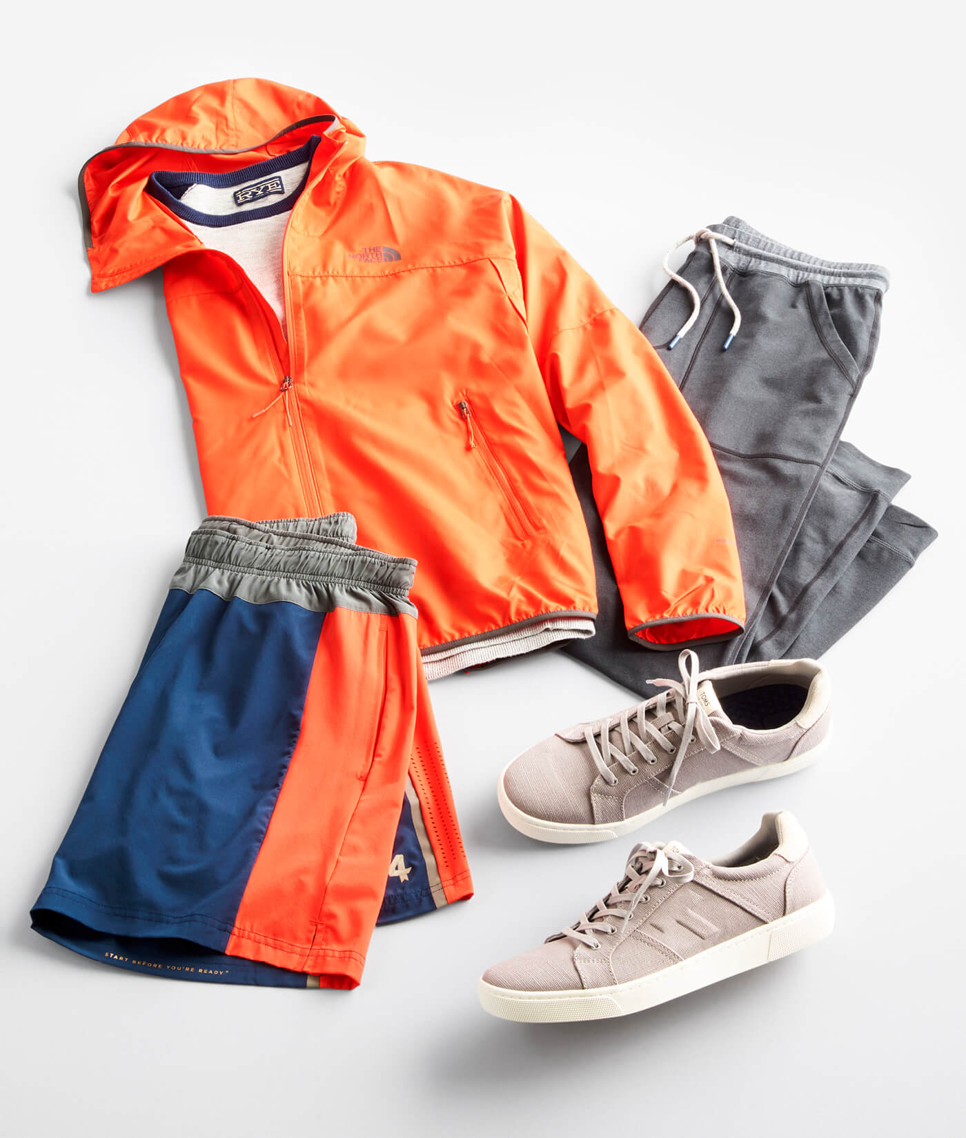 orange jacket, shorts and sneakers