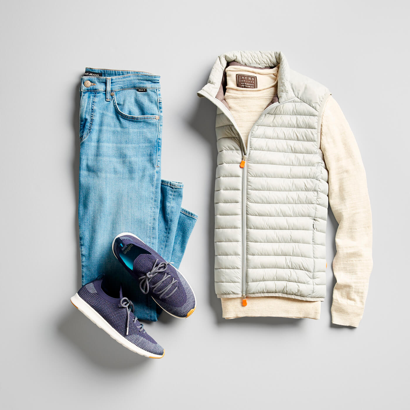 light wash jeans and puffer vest