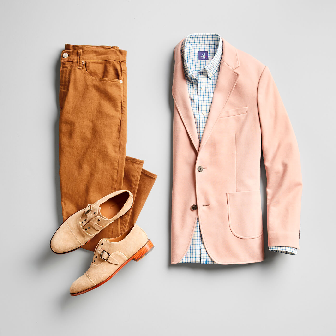colored jeans and pink blazer