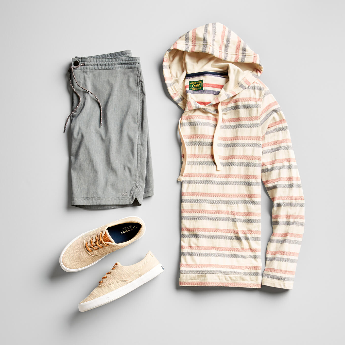 grey hybrid shorts and striped pullover hoodie