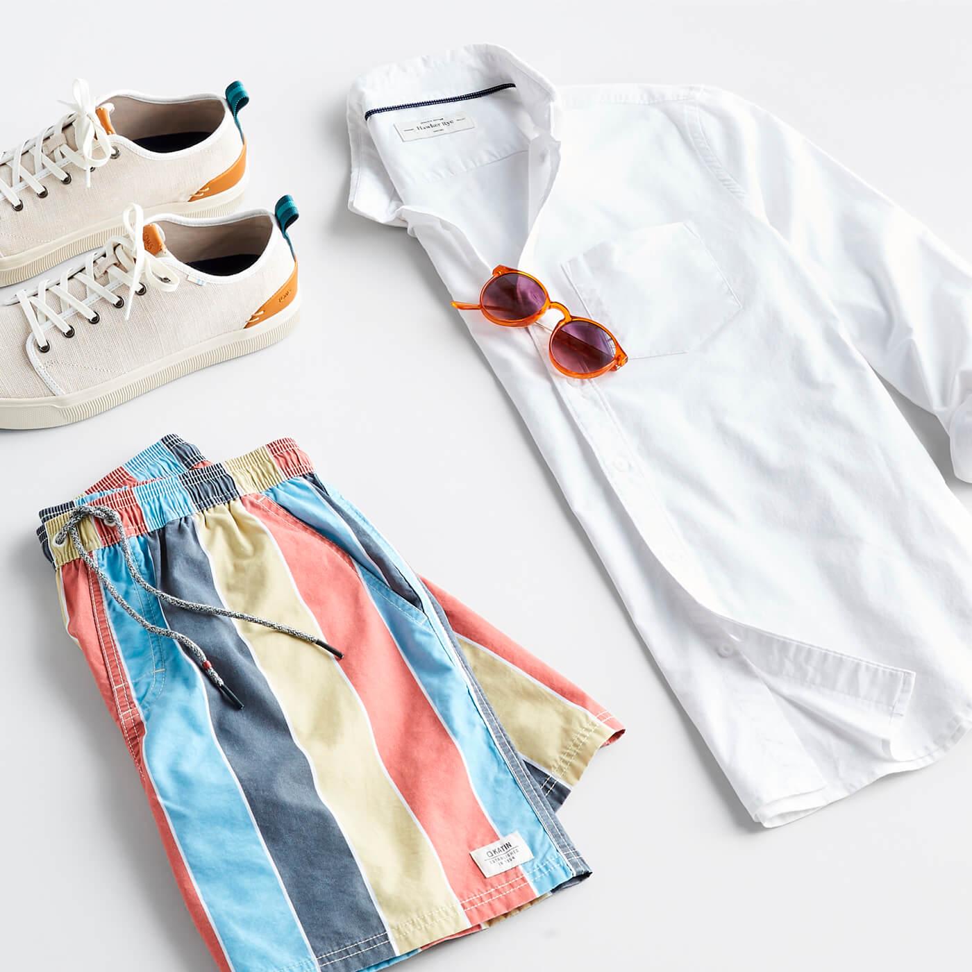 white oxford shirt with swim trunks