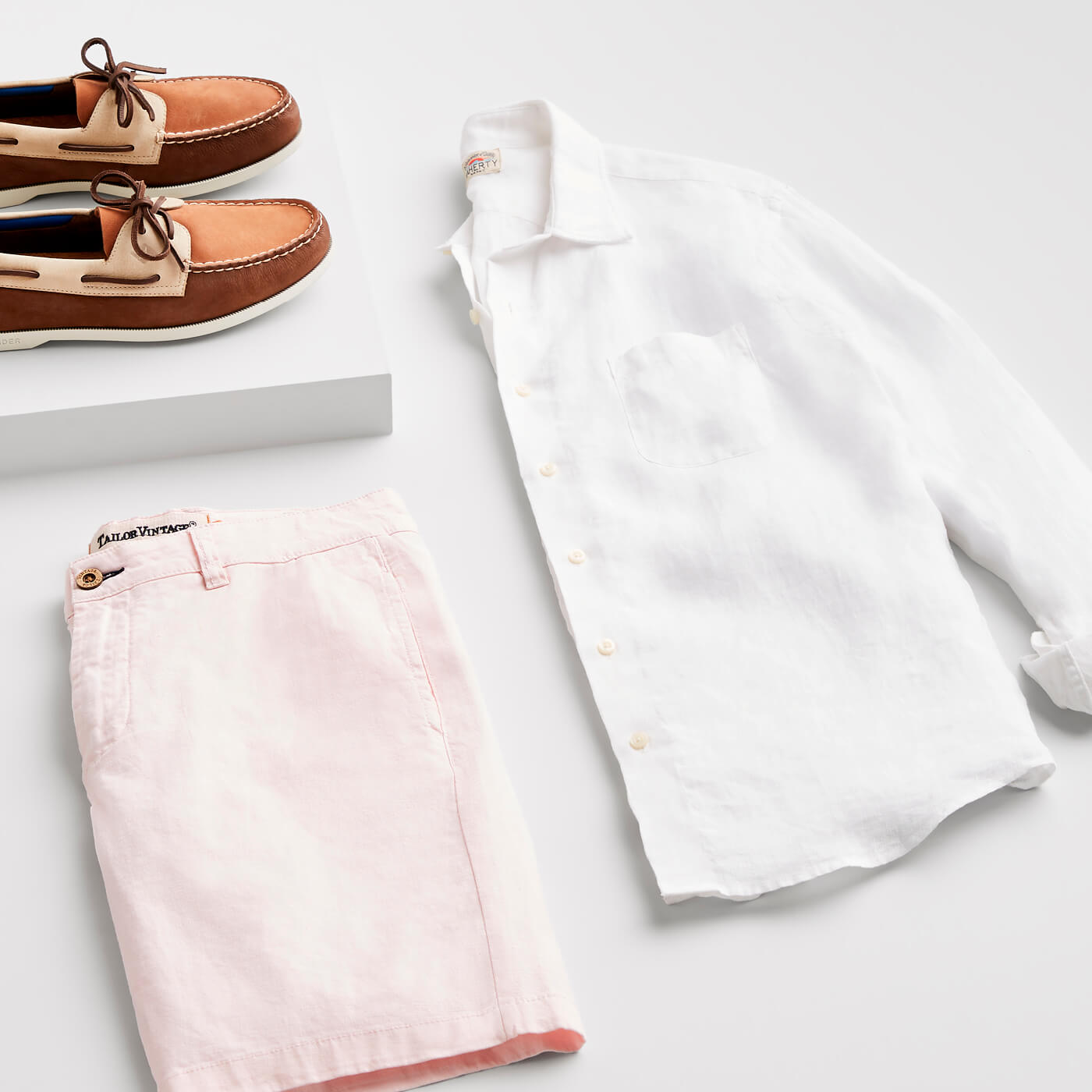 men's pink shorts and white button-up shirt