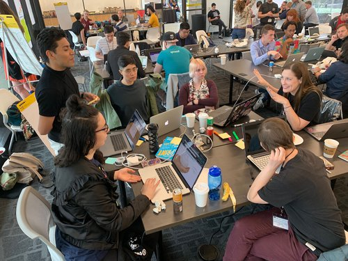 Groups working on projects at HackOut