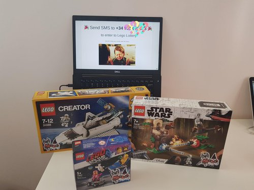 Three Space Legos as prizes for a raffle, which could be entered by SMS.