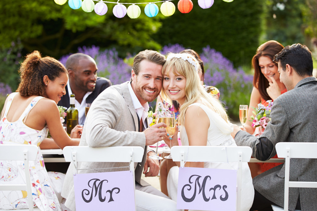 http://www.dreamstime.com/stock-photos-bride-groom-enjoying-meal-wedding-reception-looking-to-camera-smiling-image35609923