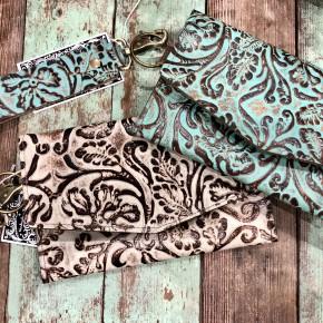 Tooled leather wristlet