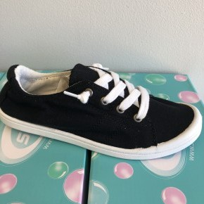 Black and white tie up slip on sneakers