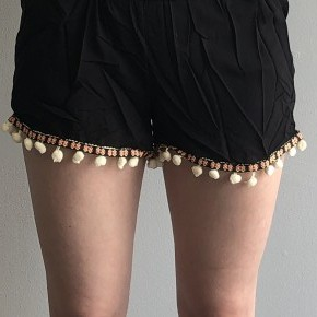 Black shorts with multi color pom trim