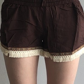 Brown shorts with aztec and tassel trim
