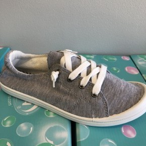 Gray and white tie up slip on sneakers