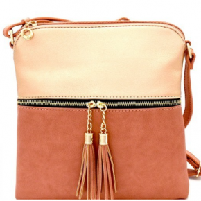 The Raven Crossbody in rose gold/peach