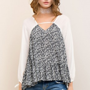 Floral Print Top with White Sleeves and V-neck Cutout.