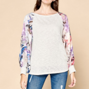 Ivory/ gray loose knit sweater with long floral puffy sleeves and round neckline