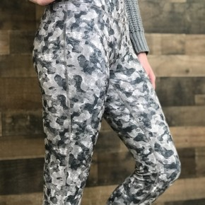 Green camo leggings with secret zipper pocket and criss-cross ankle design