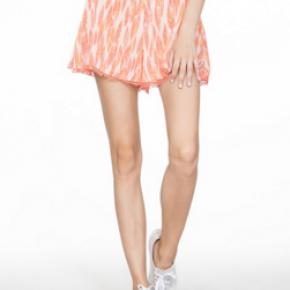 Orange cotton shorts w/ pom-pom detail on bottom