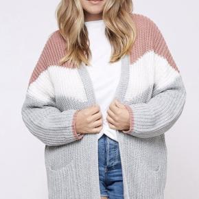 7b9c642b331 Plus size color block knit cardigan featuring longline