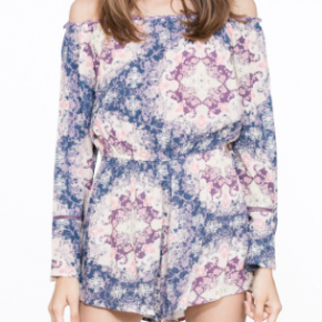 Multi off-shoulder printed romper with lace details.