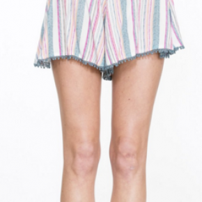 Cream cotton shorts with multi color stripes and blue pom-poms on bottom