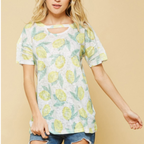 Ivory short sleeve top with lemon pattern all over it