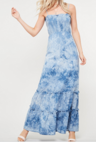 Tie dye maxi dress featuring adjustable shoulder straps, smoked bodice with ruffle, and tiered ruffle hem design