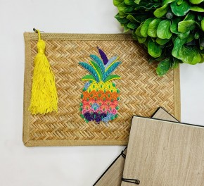 Wicker weaved clutch with beaded pineapple on front and tassel