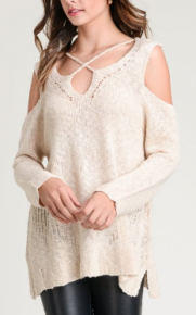 Natural Solid, lightly distressed knit sweater top with strappy detail on neck and back and long sleeves featuring cold shoulders.