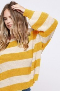 Striped knit plus size sweater featuring long sleeves, crew neckline, dropped shoulder and loose-fit silhouette.