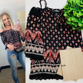 Black spaghetti strap cold shoulder top with elephant pattern around bottom