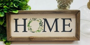 """Wooden framed """"home"""" sign with wreath as the O"""