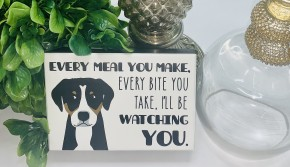 """Wooden block with dog and saying """"every meal you make, every bite you take, I'll be watching you"""""""