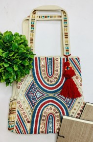 Ivory tote with beaded design on front and two side pockets